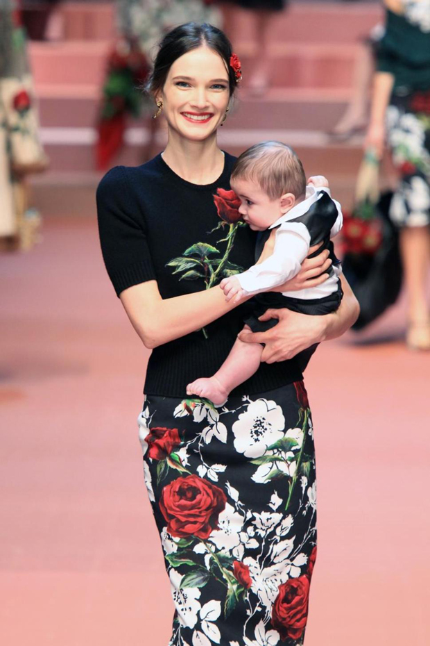 e86ebd717a Dolce   Gabbana s motherhood-themed Fall Winter 2015 show at Milan Fashion  Week on Sunday featured models carrying babies and prints inspired by  children s ...